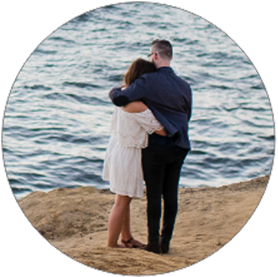 man-and-woman-hugging-on-beach