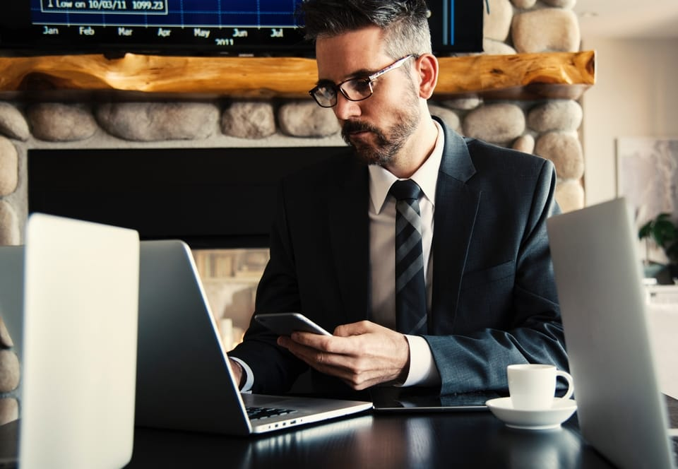man-in-suit-working-on-laptop