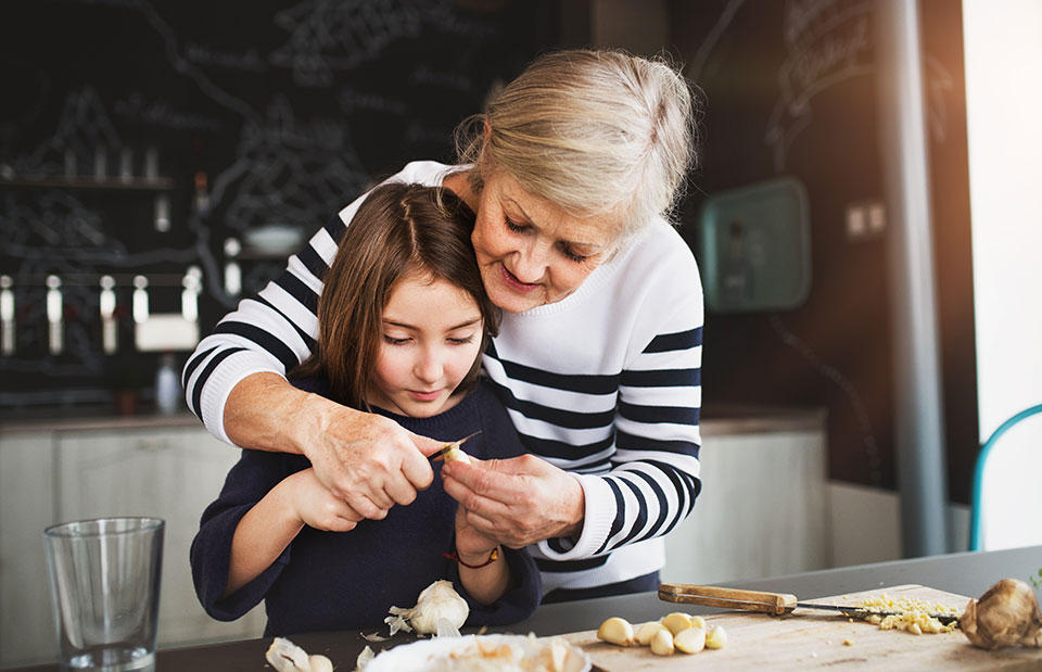 grandmother and granddaughter baking