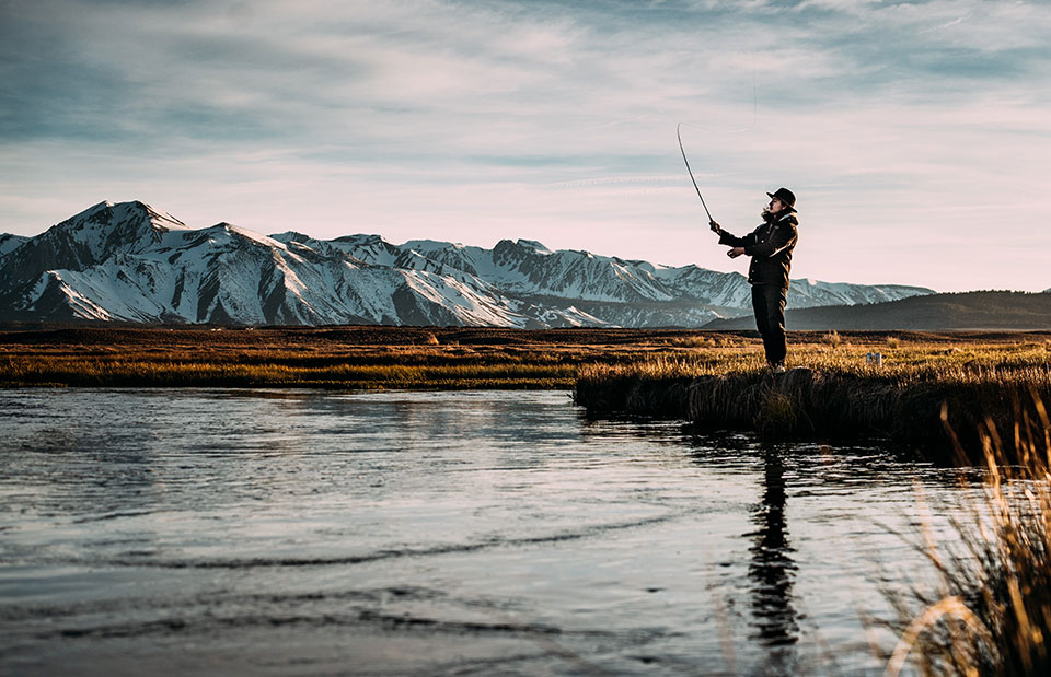 man-fishing-on-river