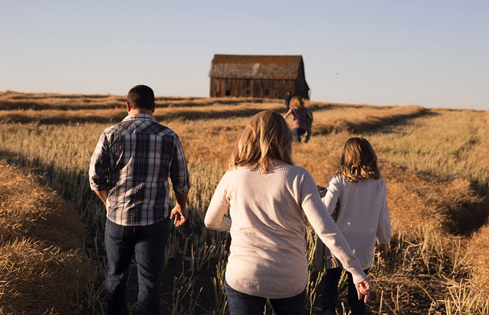 family-walking-through-field