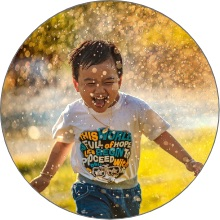 kid-running-in-sprinkler