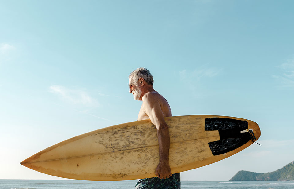 man-with-surfboard